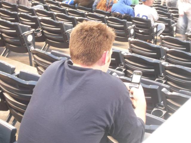 A real baseball fan enjoying the game.