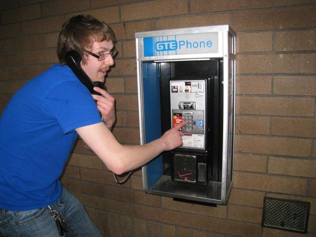 Pictured above:  The last payphone on Planet Earth.