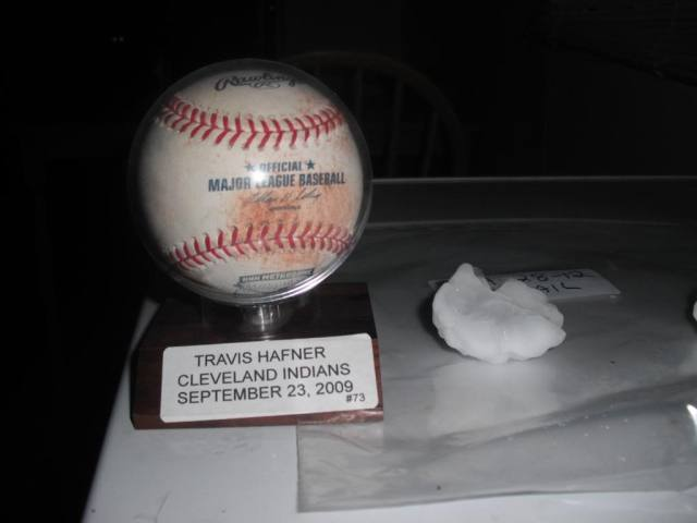 Here's a ball that Travis Hafner once hit sitting next to a hailstone.  Which is more valuable to me?