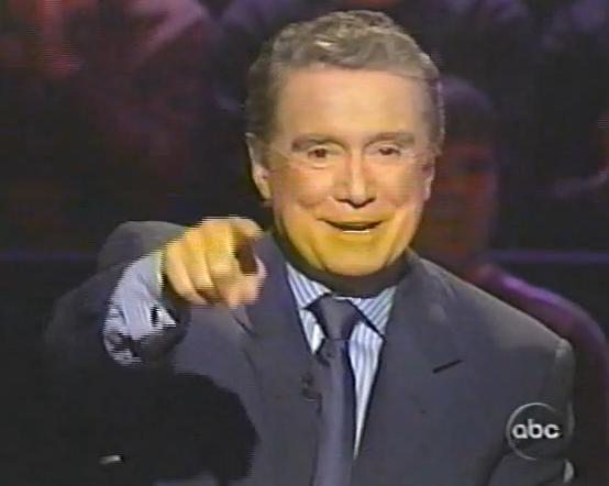 The consummate professional, Regis can even work with creepy people lingering over his shoulder.