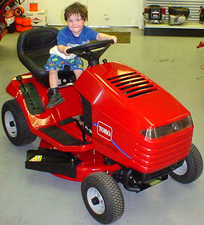 I so need one of those... the tractor, not the kid.