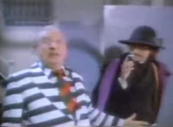 But he gets major props for bringing in Father Guido Sarducci for the video.